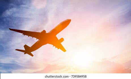 Airplane take off on the blue sky, big jet plane flying on blue cloudy sky background