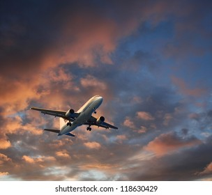 Airplane takeoff or landing against dramatic cloudscape background