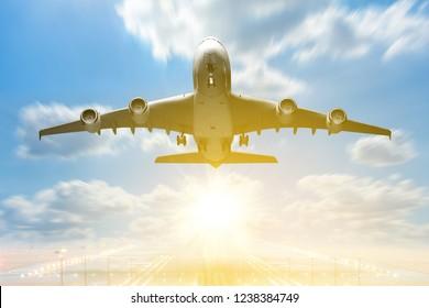 Airplane takeoff to the sunrise sky