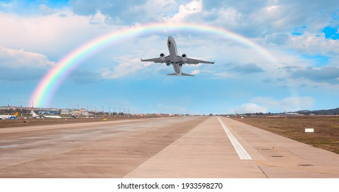 Airplane taking off from the airport with rainbow
