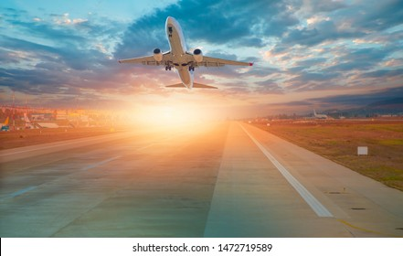 Airplane taking off from the airport at sunset - Travel by air transport