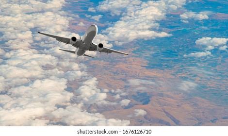 Airplane taking off from the airport - White commercial airplane flying over city and lake