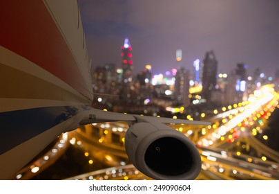 airplane taking off from shanghai in the night