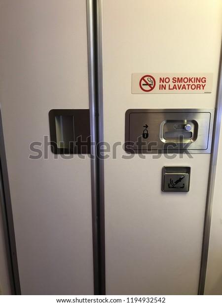 Airplane Toilet Door Closed Stock Photo (Edit Now) 1194932542