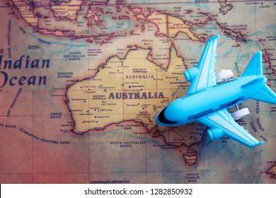 Airplane toy at Australia part of world map. International flights to Australia concept.