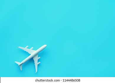 airplane toy model on blue background