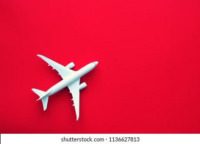 airplane toy model on red background