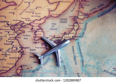 Airplane toy near Japan part od world map. Flights to Japan concept.