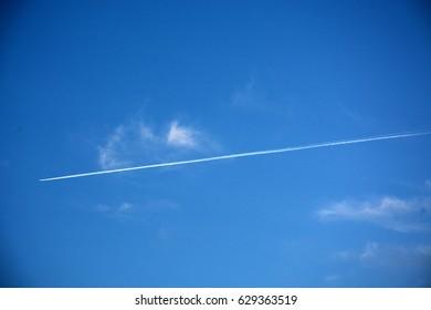 Airplane trail on a blue sky