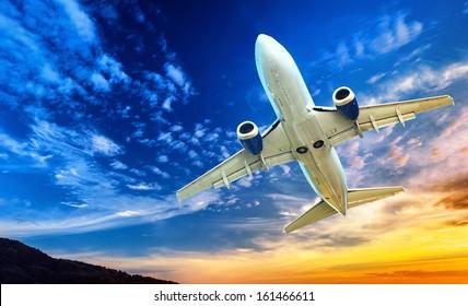 Airplane transportation. Jet air plane flies in blue sky