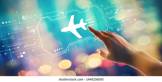 Airplane travel theme with hand pressing a button on a technology screen