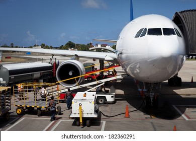 Airplane Unloading the Luggage at San Andres Airport in Colombia