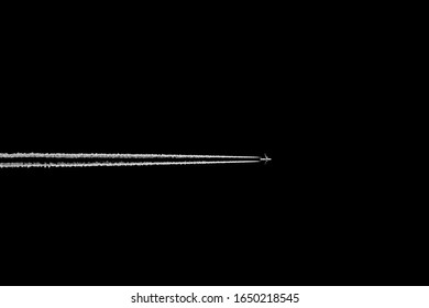 Airplane and vapor trail. Aircraft flying high in the black skies