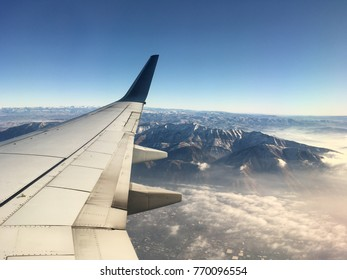 Airplane View pre landing, overlooking the mountains and city of Salt Lake City Utah.