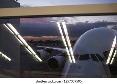 Airplane waiting for boarding at gate.