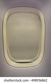 Airplane window closed, closeup