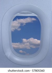Airplane window of an jet airplane with a beautiful sky