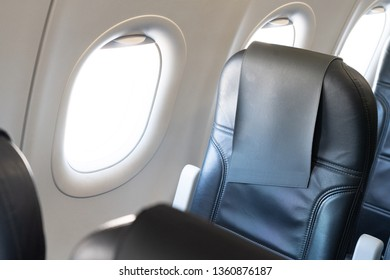 Airplane window seat with isolated   white window inside the aircraft