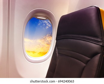 Airplane window with view on a beautiful sky.