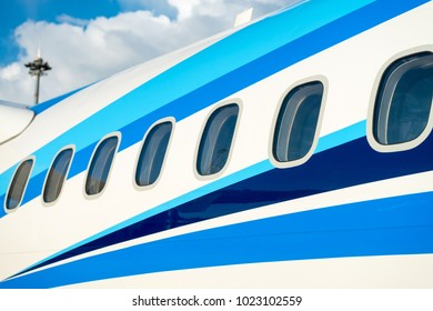 Airplane windows in passenger aircraft with outside view