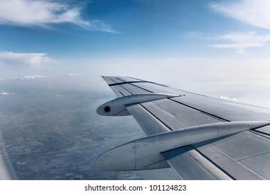 Airplane Wing in Flight, looking through window