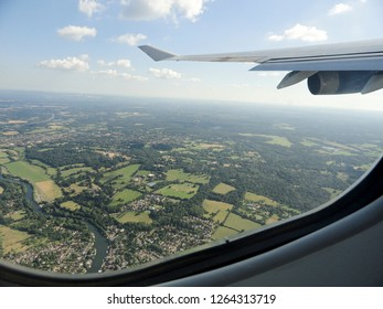Airplane Wing Flying Over British Countryside