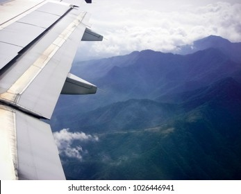 Airplane Wing Flying over Moutains in Central America