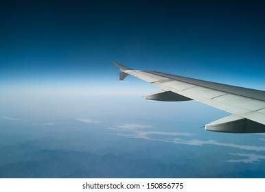 Airplane wing on the sky