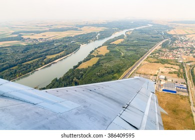 Airplane Wing On The Window With Landscape View