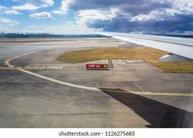 Airplane wing with its shadow projected on the tarmac during take off. Travel concept.