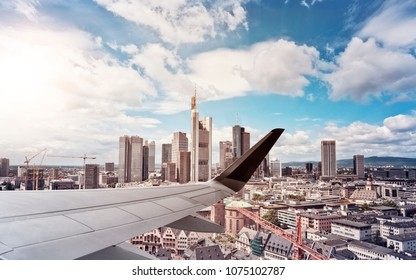 Airplane Wing with Skyline of Frankfurt am Main, Germany, financial capital of the european union