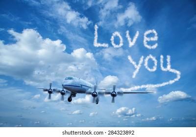 Airplane writes with smoke love you