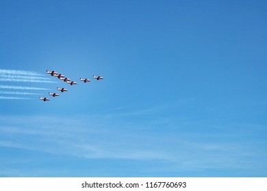 Airplanes on airshow or aerobatics event flying in delta shape formation. Aerobatic team performs flight at air show at Abbotsford