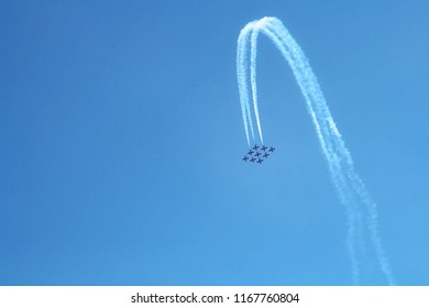 Airplanes on airshow or aerobatics event flying reverse formation. Aerobatic team performs flight at air show at Abbotsford