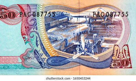 Airplanes in repair hangar, Portrait from Indonesia 50 Rupiah 1968 Banknotes. An Old paper banknote, vintage retro. Famous ancient Banknotes. Collection.