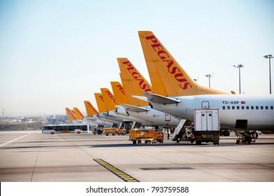 Airplanes waiting at the airport waiting for their flight. Sabiha Gokcen Airport. Airplanes belonging to Pegasus Airlines. Baggage handling vehicles. Istanbul. Pendik. Turkey. November 2017.