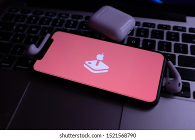 Airpods and iphone 11 and Apple Arcade logo. Apple Arcade is a video game subscription service. United States, New York, Thursday, October 3, 2019.