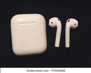 AirPods on the black background