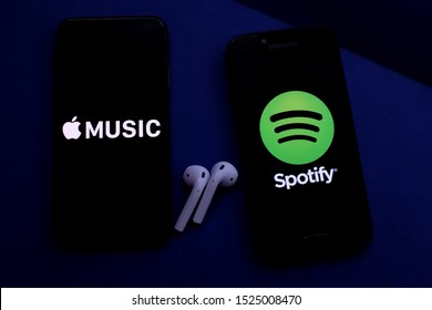 Airpods and smartphones with the Apple and Spotify logo. Apple Music and Spotify are popular online music services. United States, New York, Tuesday, October 8, 2019
