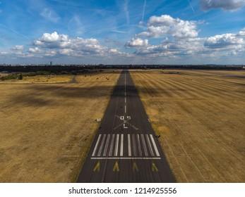 Airport airstrip, runway in Berlin by drone