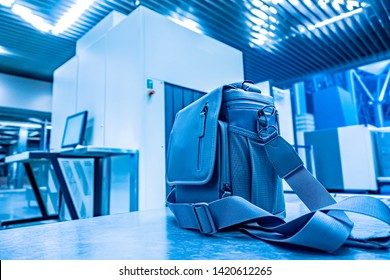 Airport. A bag on the baggage check conveyor belt. Pre-flight luggage inspection at the airport. Special tape x-ray scanner. Pre-flight control. Airport security. Waiting for a flight.