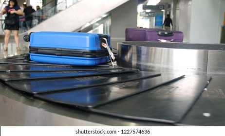 Airport baggage claim with luggage spinning around conveyor
