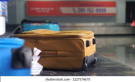 Airport baggage claim with luggage spinning around conveyor