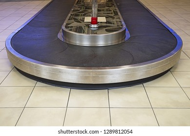 airport baggage reclamation area conveyor with no luggage
