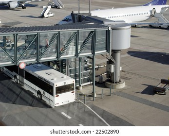 Airport bus next to gangway and airplane