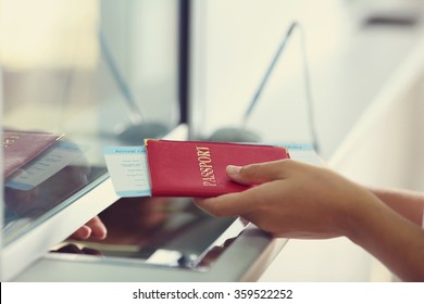 Airport Check-In Counters With Passengers