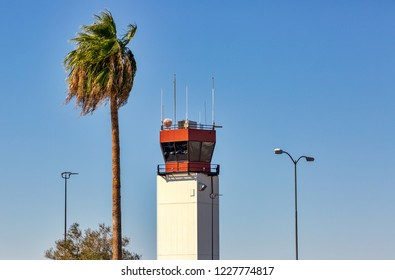 Airport Control Tower with accompanying palm tree and lamp posts