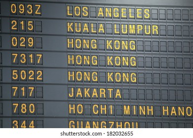 Airport departure board showing flight information