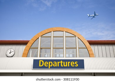 Airport departure sign with airplane on blue sky