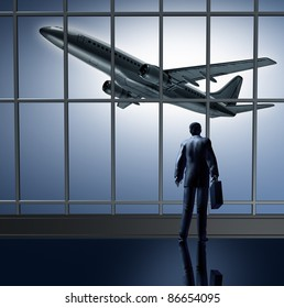 Airport departure waiting at the terminal lounge represented by a businessman standing with a briefcase in front of large glass windows looking at an airplane taking off to an unknown destination.